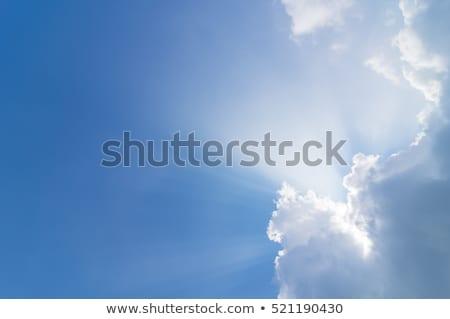 nap · sugarak · ragyogó · felhő · kék · naplemente - stock fotó © juhku