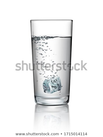 Glass of water with ice and splash Stock photo © karandaev