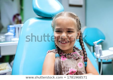 Kid visiting dentist office in hospital for pulling out milk too Stock photo © zurijeta
