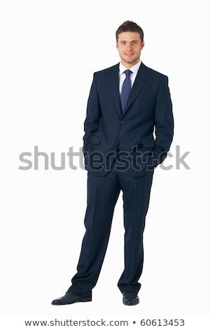 lado · homem · de · negócios · em · pé · mãos · vista · lateral · sorridente - foto stock © feedough