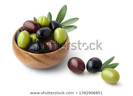 Verde aceitunas negras tazón blanco toalla alimentos Foto stock © dashapetrenko