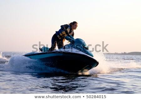 Nő jet ski tenger mosolyog ünnep szín Stock fotó © monkey_business