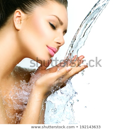 Young beautiful woman under the stream of water Stock photo © julenochek
