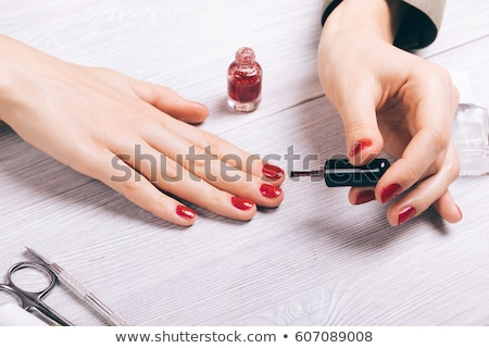nail painting with red lacquer Stock photo © OleksandrO