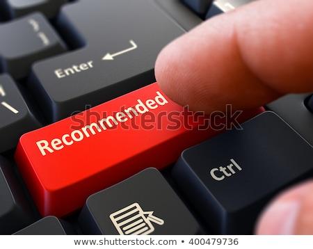 Pressing Red Button Recommended on Black Keyboard. Stock photo © tashatuvango