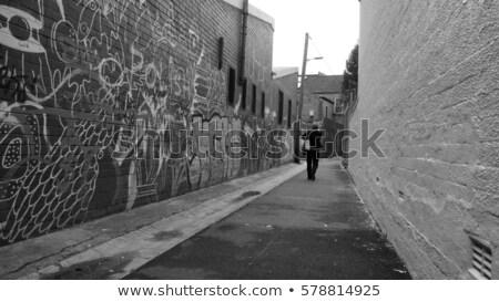 Woman walking down an alleyway Stock photo © IS2