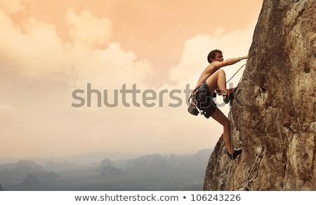 férfi · mászik · hegyek · kötél · kő · sisak - stock fotó © rastudio