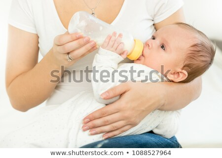 mother giving the bottle to her baby stock photo © is2