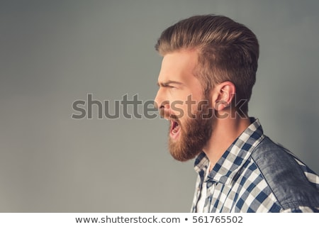 Side view of Screaming happy bearded man in business clothes Stock photo © deandrobot