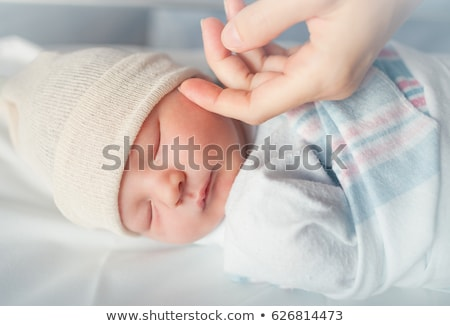 Stock photo: Mother touching face of baby