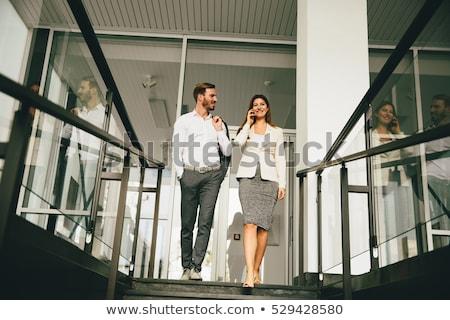vonzó · pár · lépcsősor · öltöny · belső · női - stock fotó © boggy