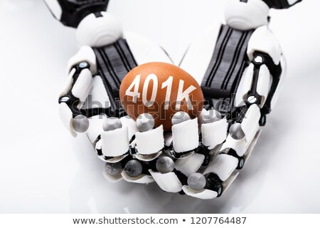 Robot Holding 401k Brown Egg Stock photo © AndreyPopov