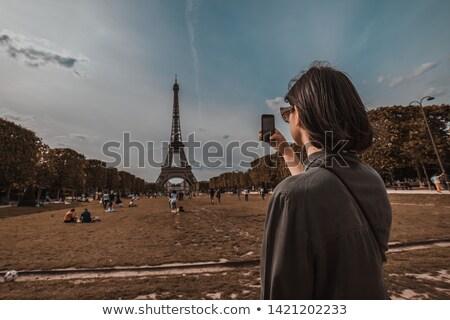 молодые привлекательный женщину Эйфелева башня Париж Франция Сток-фото © artfotodima