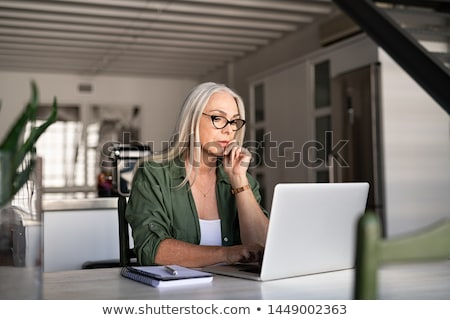 Serious senior business woman in eyeglasses Stock photo © Kzenon