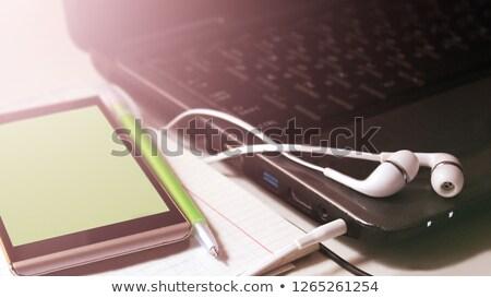 Nagy fehér fejhallgató okostelefon fa asztal kirakat Stock fotó © magraphics