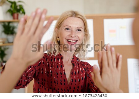Smiling businesswoman congratulating with a colleague of her Stock photo © Minervastock