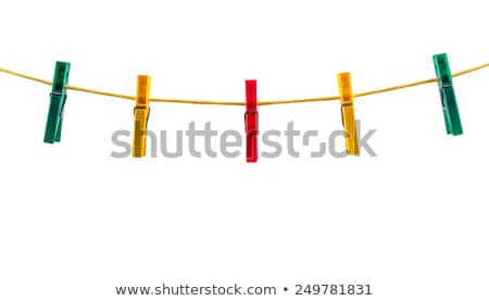 colored clothespins hold the clothes on a rope Stock photo © ruslanshramko