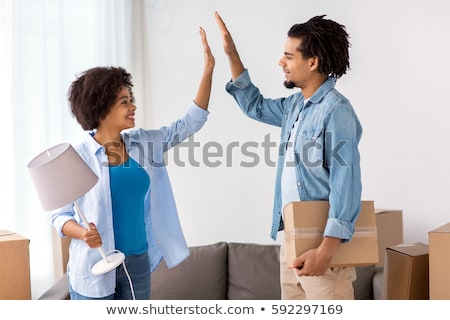 happy couple making high five gesture at new home Stock photo © dolgachov