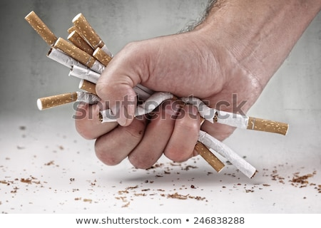 Smoking addiction concept, cigarette in hand, bad habit Stock photo © MarySan