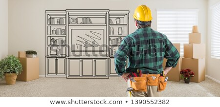 Contractor Inside Room With Boxes Facing Entertainment Unit Draw Stock photo © feverpitch