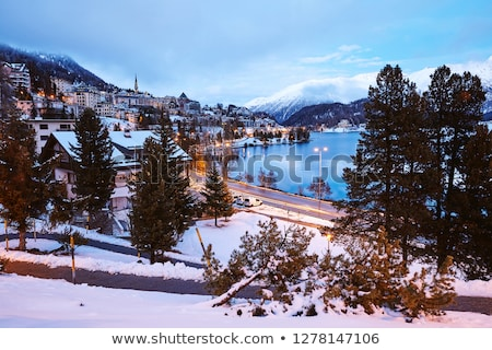 Saint Moritz town in winter season at sunset Stock photo © frimufilms