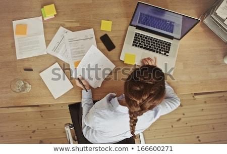 Businesswoman working at her desk in office Stock photo © Elnur
