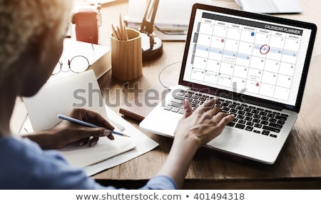 Businesswoman Scheduling The Plan Using Calendar And Laptop Stock photo © AndreyPopov