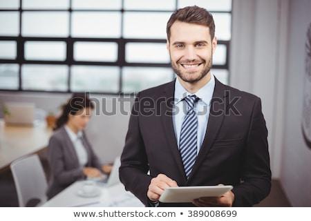 Gelukkig kaukasisch zakenvrouw permanente Stockfoto © wavebreak_media