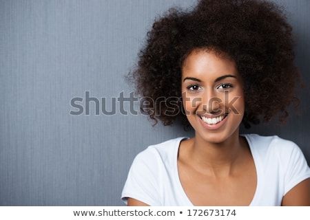 Front view of beautiful african-american woman posing while standing on beach on a sunny day Stock photo © wavebreak_media