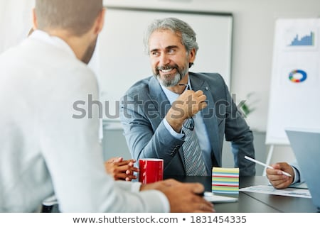 Businessman in Office Work Cheerful Boss Working Stock photo © robuart