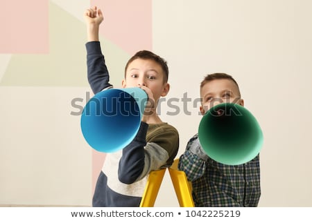 little boy speaking to megaphone Stock photo © dolgachov