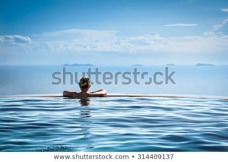 Luxe vakantie vrouw ontspannen oneindigheid zwembad Stockfoto © Maridav