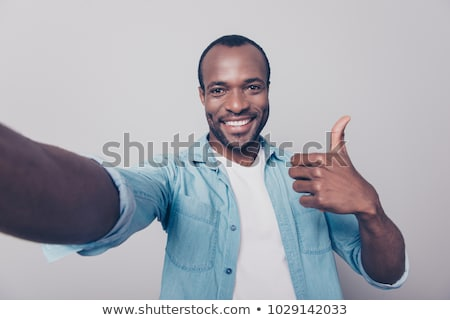man or blogger taking selfie and showing thumbs up Stock photo © dolgachov