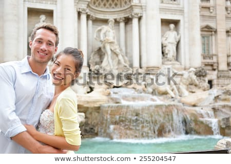 Rome couple on romantic date by Trevi Fountain in Roma, Italy. Romantic luxury honeymoon Europe crui Stock photo © Maridav