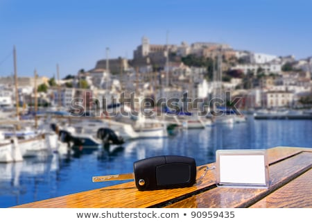Car rental keys on wood table in Mediterranean vacation Stock photo © lunamarina