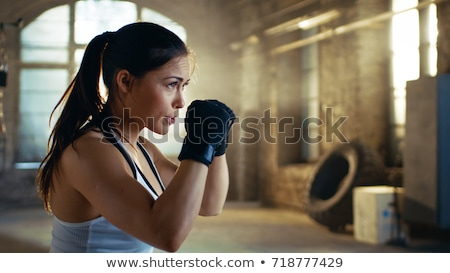 Woman defending herself Stock photo © photography33