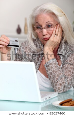 Elderly lady confused by prospect of shopping on line Stock photo © photography33