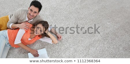 Man laying new carpet in room Stock photo © photography33