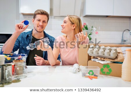 young woman sorting plastic bottles Stock photo © photography33