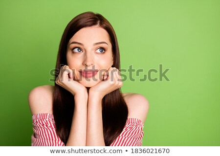 Girl wear red shirt holding hands on chin stock photo © grafvision