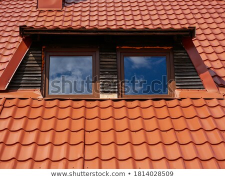 beautiful cloud and dormer window with red tiled roof stock photo © anshar