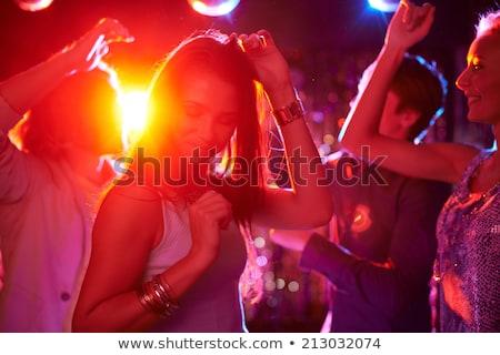 Beautiful Brunette Dancing Night Disco Lights Stock photo © Pressmaster