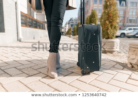 woman legs with a suitcase on the white background Stock photo © evgenyatamanenko