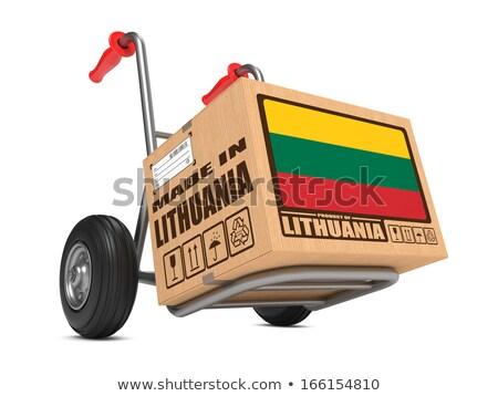 Made in Lithuania - Cardboard Box on Hand Truck. Stock photo © tashatuvango