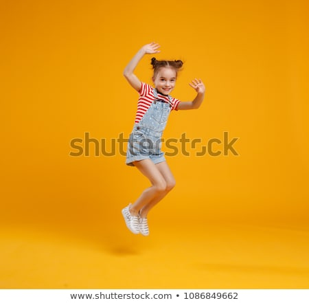 portrait of beautiful little girls jumping stock photo © len44ik