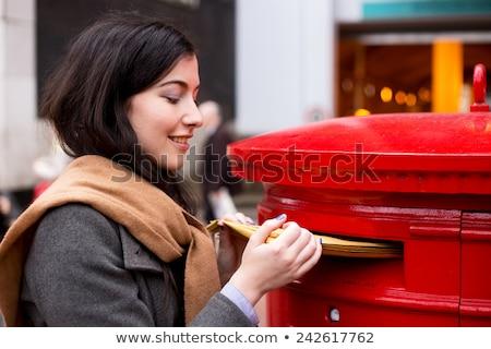 Jovem senhora cartas mulher jovem carta envelope Foto stock © kasto
