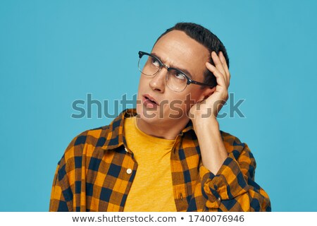 Young man with grimace of disgust Stock photo © d13