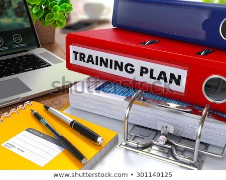 Rood kantoor map opschrift agenda desktop Stockfoto © tashatuvango