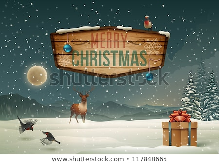 ornamental christmas tree with reindeers gift boxes and snowfla stock photo © bluelela