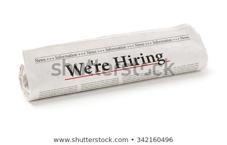 rolled newspaper with the headline we are hiring stock photo © zerbor